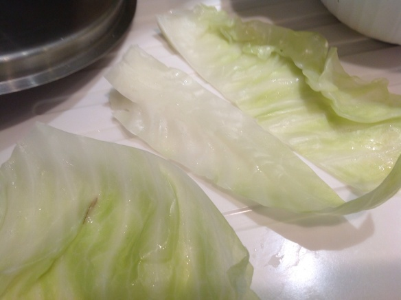 The cabbage leaves ready to stuuf, the tough spine removed to ease the rolling