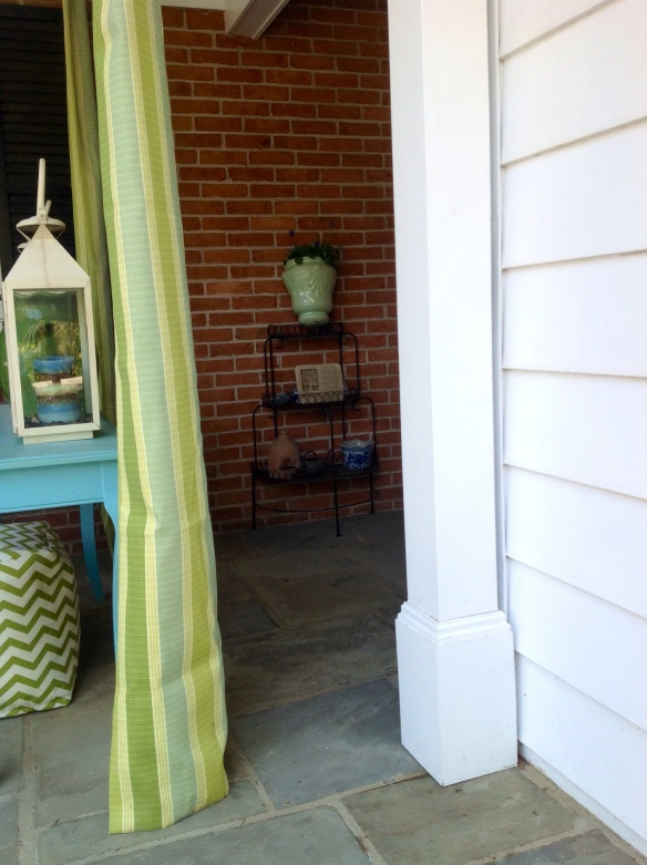 The entrance to the mudroom door behing the porch curtains