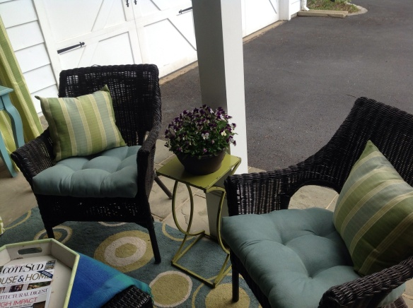 Throw pillows are made from left over drape fabric. Small table between chairs for drink placement or to hold flowers.
