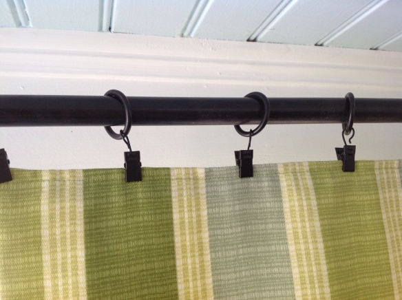 Using outdoor fabric, I made 4 curtain panels to deleniate the space, bring in color and pattern, flow in the breezes and make the space feel like a room. I simply hung them on really sturdy curtain rods with loops that clip onto the panels. I store them, clips and all, by folding them. After 3 seasons the fabric has not faded nor absorbed dirt. Amazing! I think they make the space.