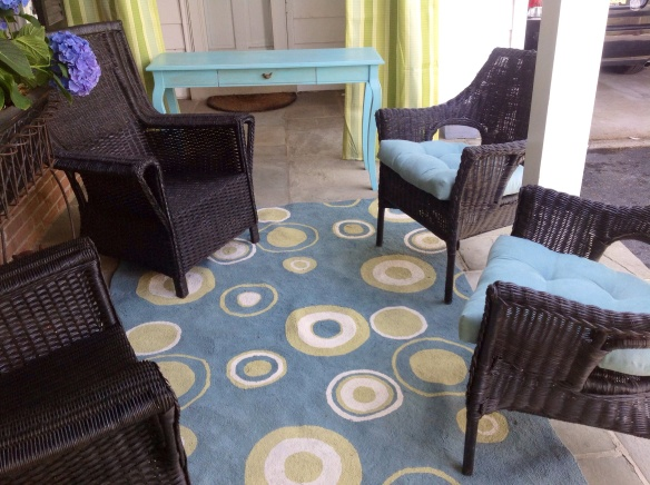 Adding to the 2 existing black wicker chairs from Pier I, I spray painted 2 thrift shop finds in black Krylon paint. Although not matching, the 4 chairs work together