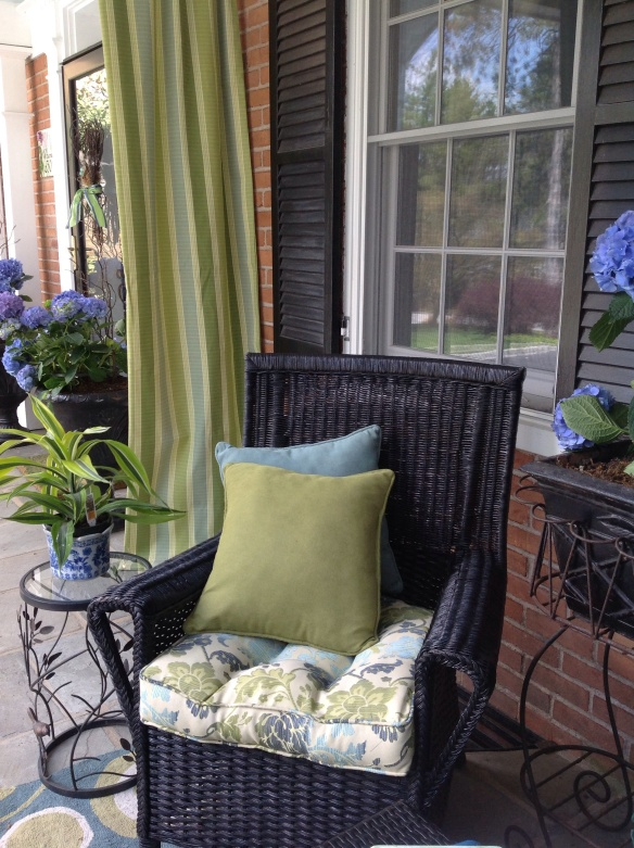 Linens on chair are complimentary but not matched to the other chairs. They are comfortable and colorful. Another small side table with a bird and vine motif is useful but unobstructive to traffic flow.
