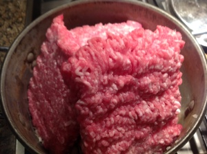 Ground pork ready to be browned and seasoned