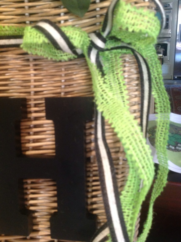 I played around with the ribbon deciding to layer the black and whit steiped over the chartreuse jute ribbons and offset a simple bow to the right.