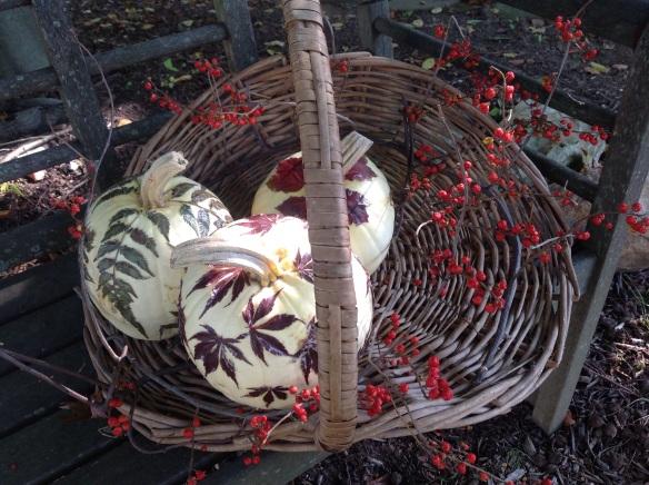 A pretty fall vignette on a garden bench