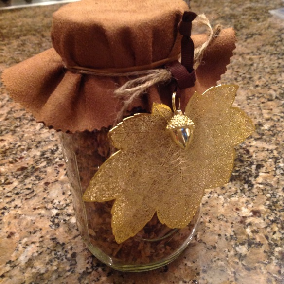 Another Mason jar with a nature-inspired gold leaf ornament attached, a second gift for the holiday season ahead!