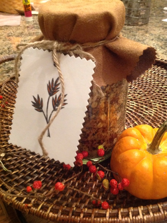 In a claasic Bell or Mason jar, with a suede fabric round to conceal the lid, tied on with natural twine.  Gift tag cut from a logo from a box of Raincoast crackers, which I recycled.