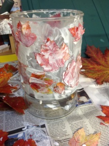 "Moisten your leaves with a bit of water to make them pliable, then dip in glue, ahere on the glass in a natural ""wind blown"" pattern; apply more glue on the outside of the leaf with the sponge brush."