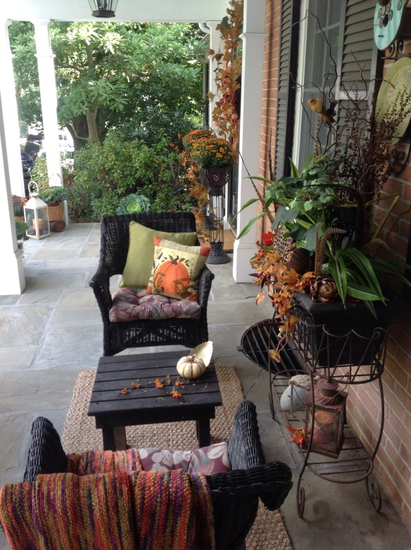 A cozy, intimate conversation area is created on the porch.