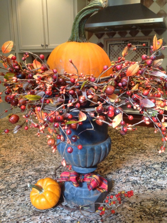 Tie a pretty bow around the base of the urn and add a spray of bittersweet and a mini Boo pumpkin and your arrangemnt is done!