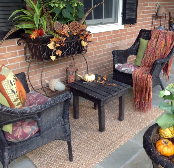 Summer cushions are replaced by autumn colors and a throw to keep warm.