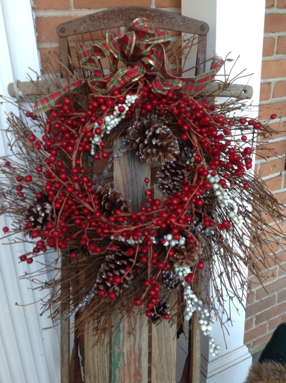 Double wreaths decorate the sleigh.