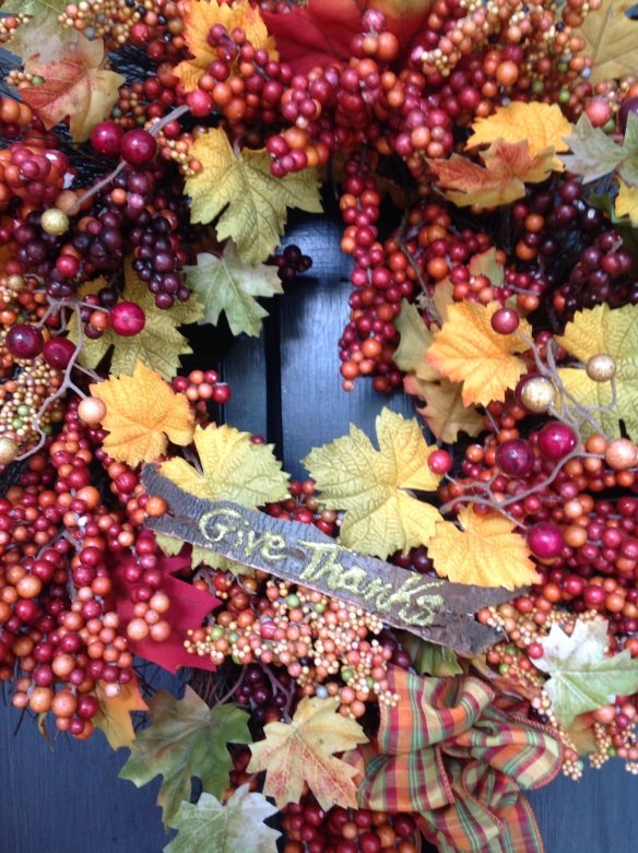 I peeled some bark off a log and wrote a Thanksgiving sentiment on it with a glitter pen then attached it to the front of my fall wreath.