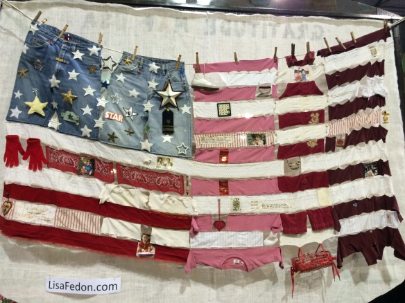 A creative flag constructed of recycled clothing.
