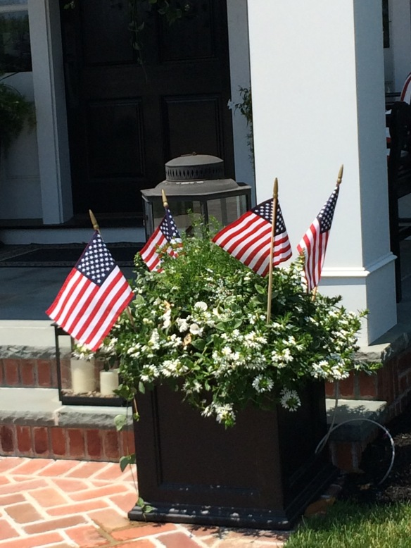 Seasonal interest can be easily achieved by the addition of a few small flags in an existing planter.