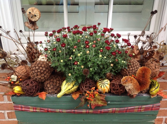 A window box planter, dressed for fall. How to here.